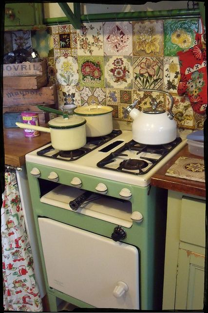Kitchen by the vintage cottage, love the old tiles in a wild combo!