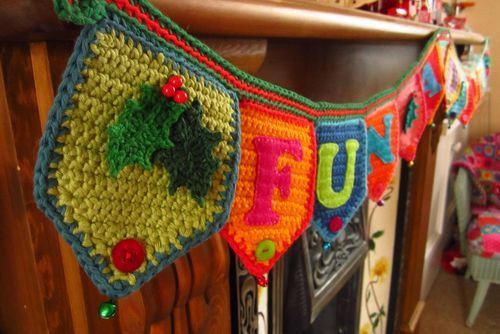 Super sweet crochet bunting from Attic24.  Love the appliqued felt letters and the little bells on the point.