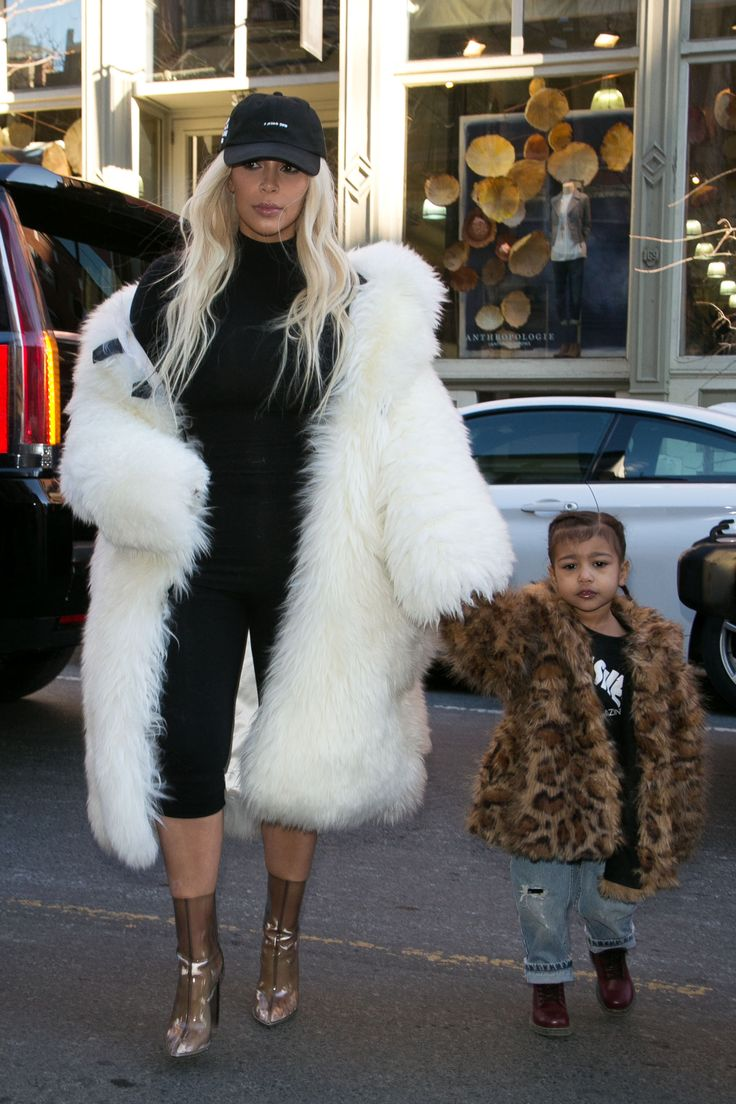 Kim Kardashian took North out for a Valentine's Day lunch and dressed the tot in a fur coat just like her own - which we're obvs hoping is fake... While North wore leopard print with jeans and boots Kim matched her OTT coat with a black jumpsuit and transparent boots.   - Cosmopolitan.co.uk