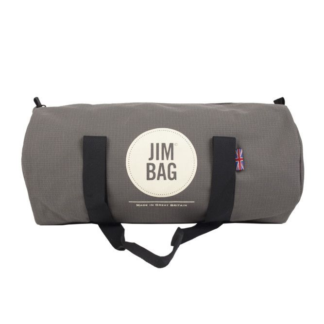 Jimbag Barrel Bag: The barrel is a medium sized bag. Its smaller size is most popular with the ladies or for JimJunkies who don't carry quite as much gym junk! This classic soft black cotton canvas style is light in weight, compact, yet durable. Edging perfectly between fashion and practicality, the JimBag branded barrel not only looks great, it's also surprisingly roomy for its size. It will comfortably fit your gym kit, towel, water bottle and toiletries. The barrel has two large woven…