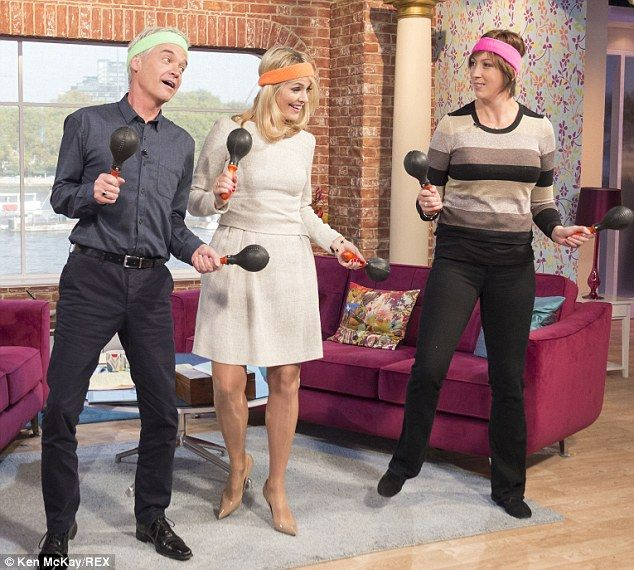 On your feet: Miranda Hart showed Phillip Schofield and Holly Willoughby moves from her new fitness DVD on This Morning on Wednesday (13/11/13)