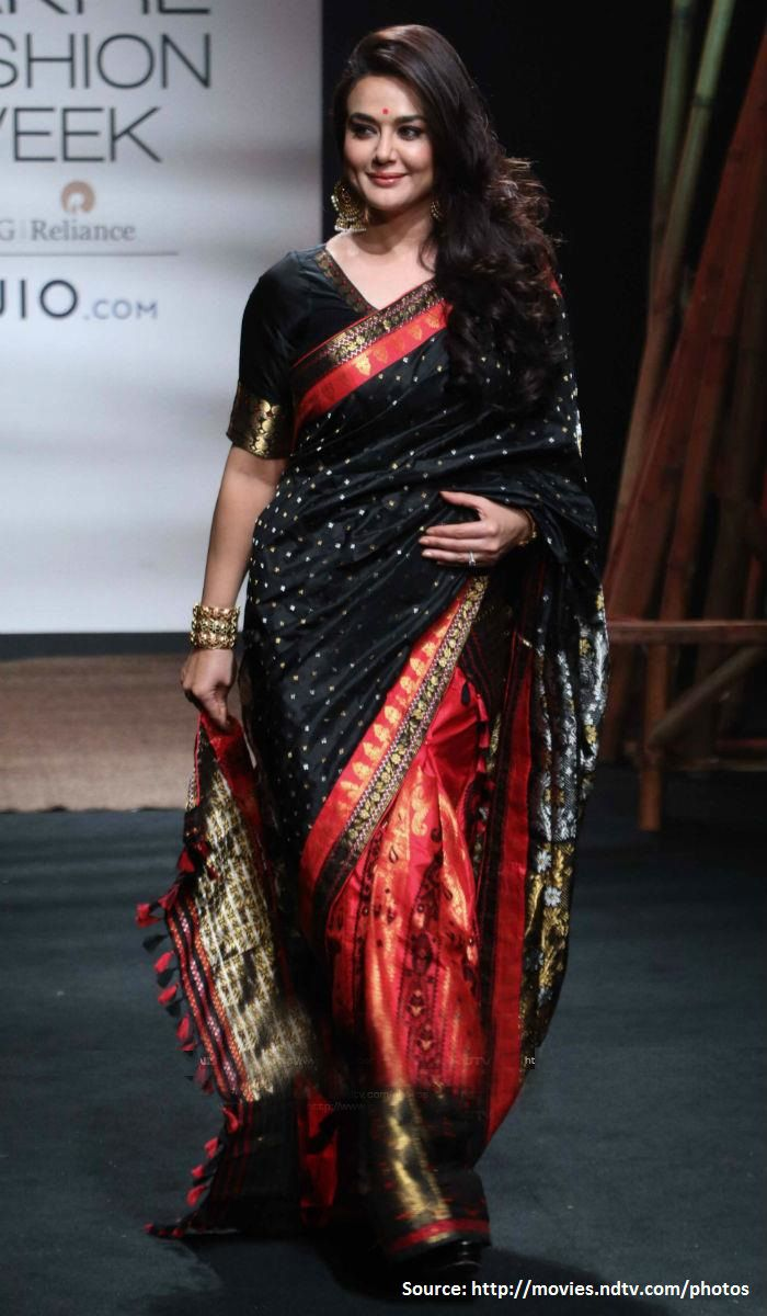 A stunning showstopper at the ongoing #LakmeFashionWeek2017 Day 2, #PreityZinta walked the ramp for #Assam based designer #SanjuktaDutta adorning a #silkblack and red-coloured sari. She looked a million bucks in this #traditionalsilk #MekhelaChador outfit with beautiful side wept curls and heavy jhumkis!