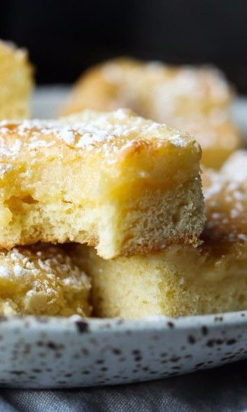 German Butter Cake-This yeasted sheet cake is also known as butterkuchen. It's a classic German sweet cake recipe that's traditionally enjoyed with a cup of coffee or hot tea in the afternoon. It has a gooey buttery topping and a sweet, chewy, base all dusted with powdered sugar. Perfect for an after dinner dessert.