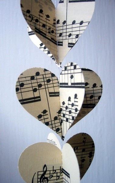 Sheet music cut-out paper hearts. Cute!