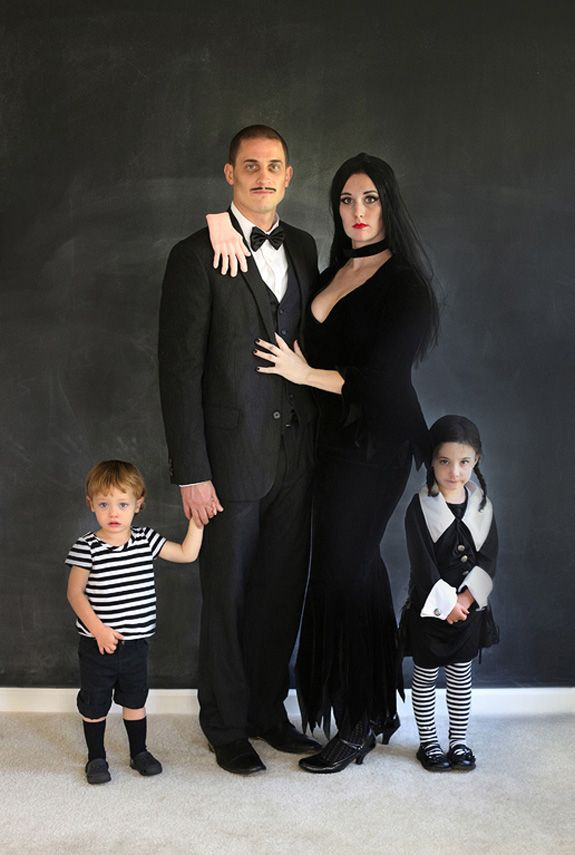 They're creepy and they're kooky... We can't think of a more fitting (and totally creepy) family costume than this. Little Pugsley and Wednesday are beyond adorable. And the hand on dad's shoulder is spookily good touch. See more at Loft 3 Photography »  - GoodHousekeeping.com