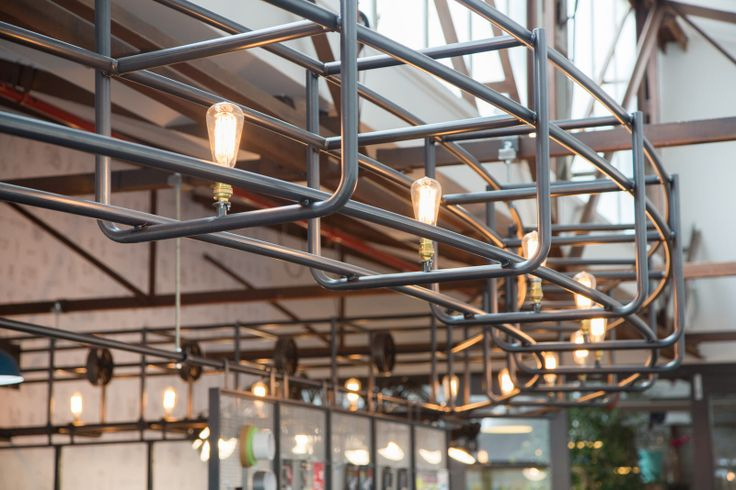 Custom Overhead Steel Lighting surrounds the central workshop.  | Duct Tape Workshop (Ponsonby Central, Auckland). | Photo by the talented Jeremy Toth | Fit out by Material Creative.