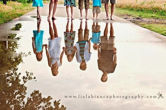 Capture your family's reflection in still water for a unique and interesting photograph. lizlabiancaphotography.com
