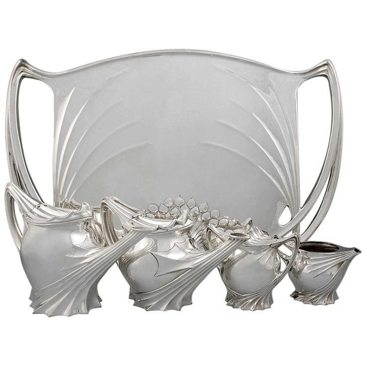 Paul Follot French Art Nouveau Silver Tea Service   From a unique collection of antique and modern tea sets at https://www.1stdibs.com/furniture/dining-entertaining/tea-sets/