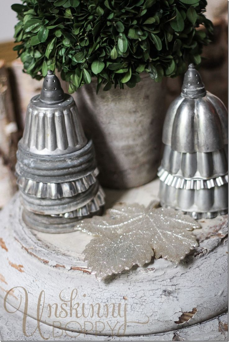 Stack layers of different shaped molds into a Christmas tree shape for winter sideboard scene. The pointy tree toppers? Those would a pair of vintage salt and pepper shaker lids.