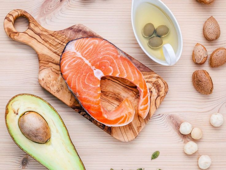 PHOTO: A selection of food sources of Omega-3 and unsaturated fats including various nuts, olive oil, salmon and avocado are pictured in an undated stock photo.