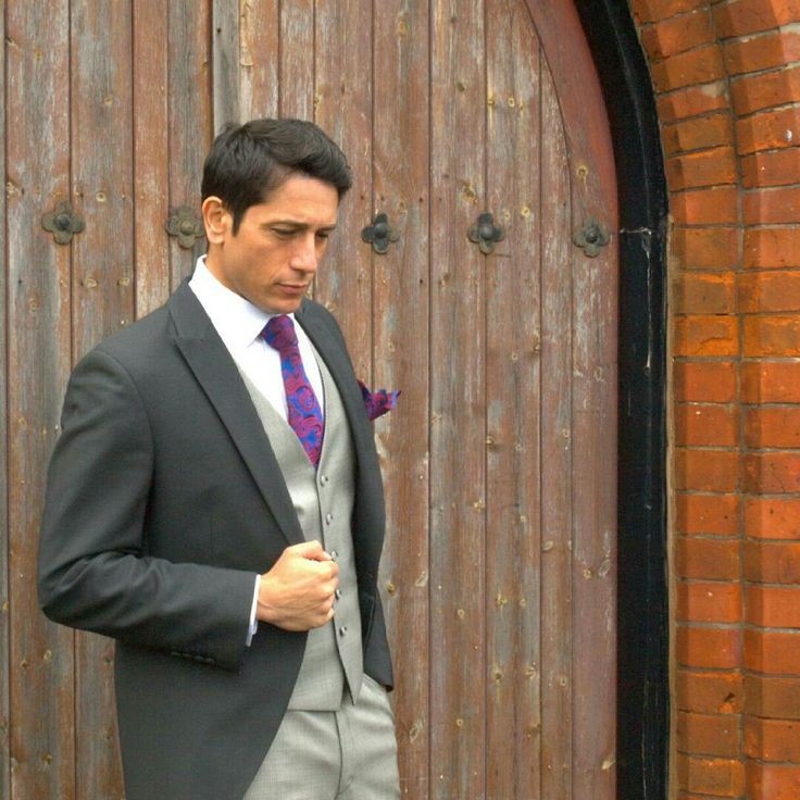 Charcoal tails with grey puppy tooth trousers and waistcoat. Looks fantastic with the Paisley tie! .#suithire #wedding #groom #bride #slim #johnyescobar.