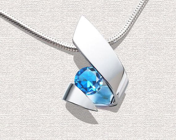 Argentium silver and blue topaz pendant designed by David Worcester for VerbenaPlaceJewelry.Etsy.com