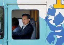Board of Supervisors President David Chiu driving the bookmobile