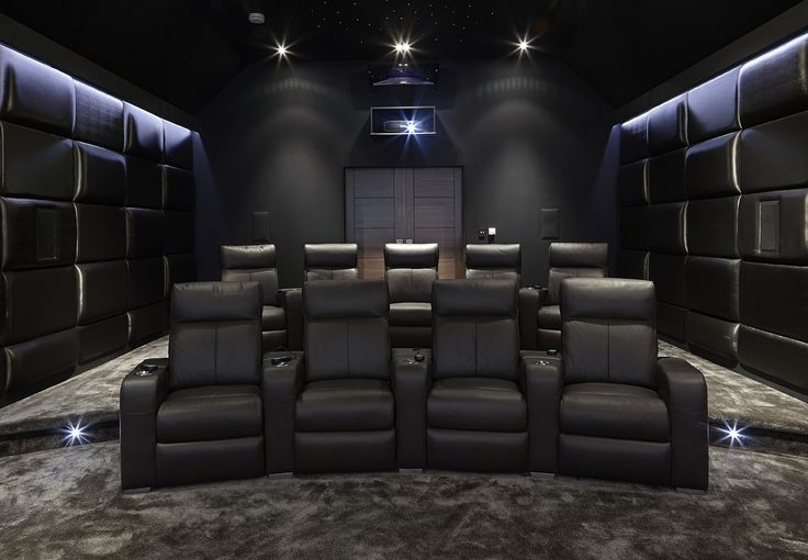 The legit home theater. Completely disagreeing with the theme of the rest of the house buts thats ok. This is how it should look. I hope there is extremely good surround sound in those walls and they better be soundproof.