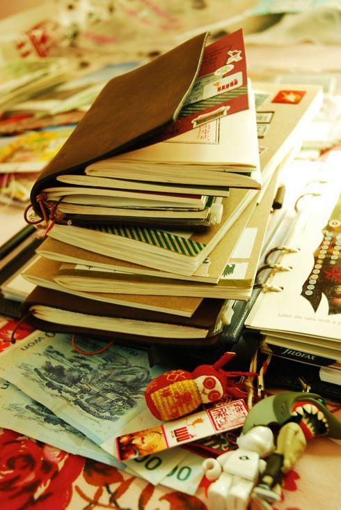 stack of travel journals