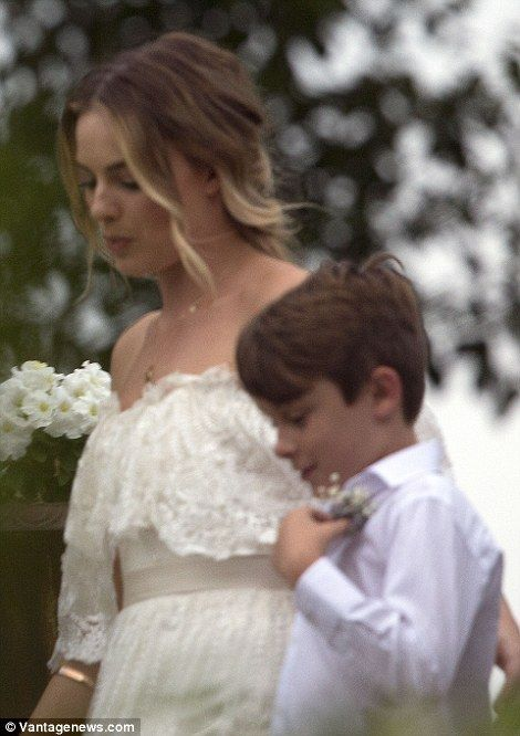 Here comes the bride! Margot Robbie enjoyed a sweet moment with her family after marrying her longtime boyfriend Tom Ackerley in a secret wedding in Byron Bay - December 2016