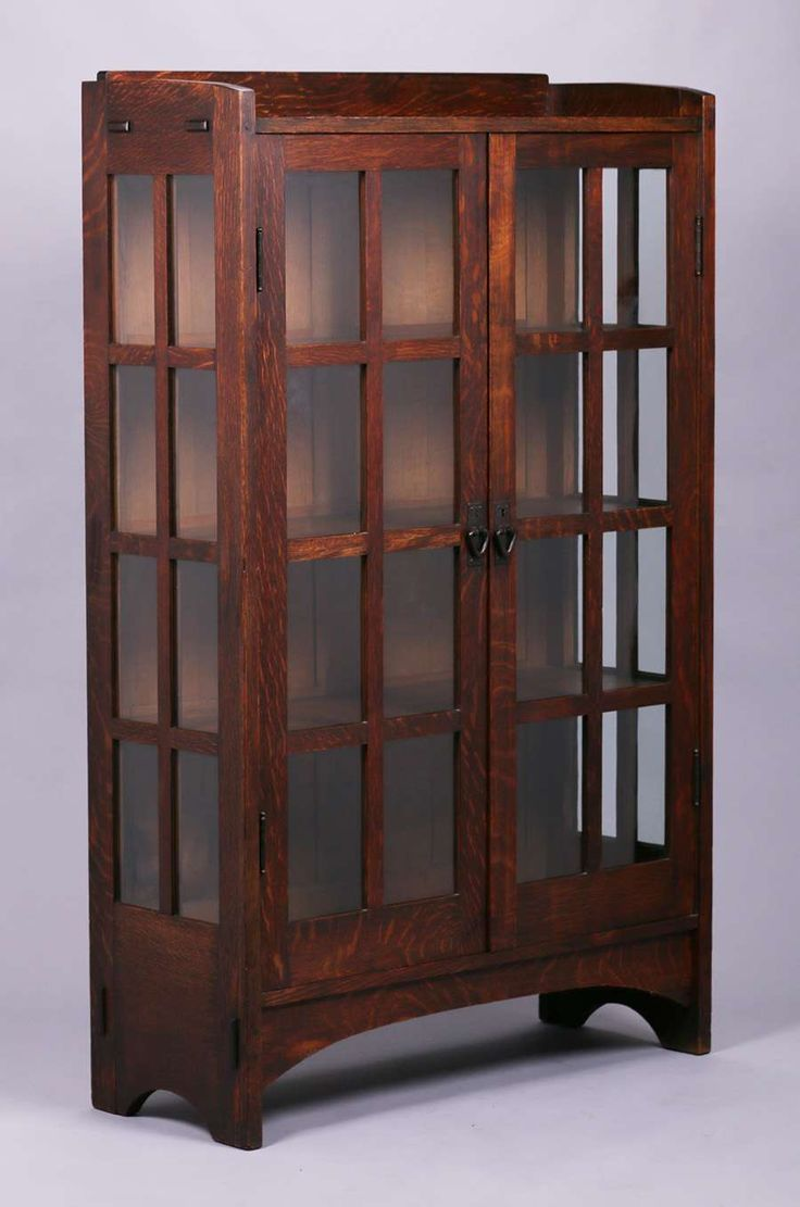 2957. Gustav Stickley two-door china cabinet #815.  Signed with paper label on back.  Excellent original finish.  64″h x 40″w x 15″d $9500