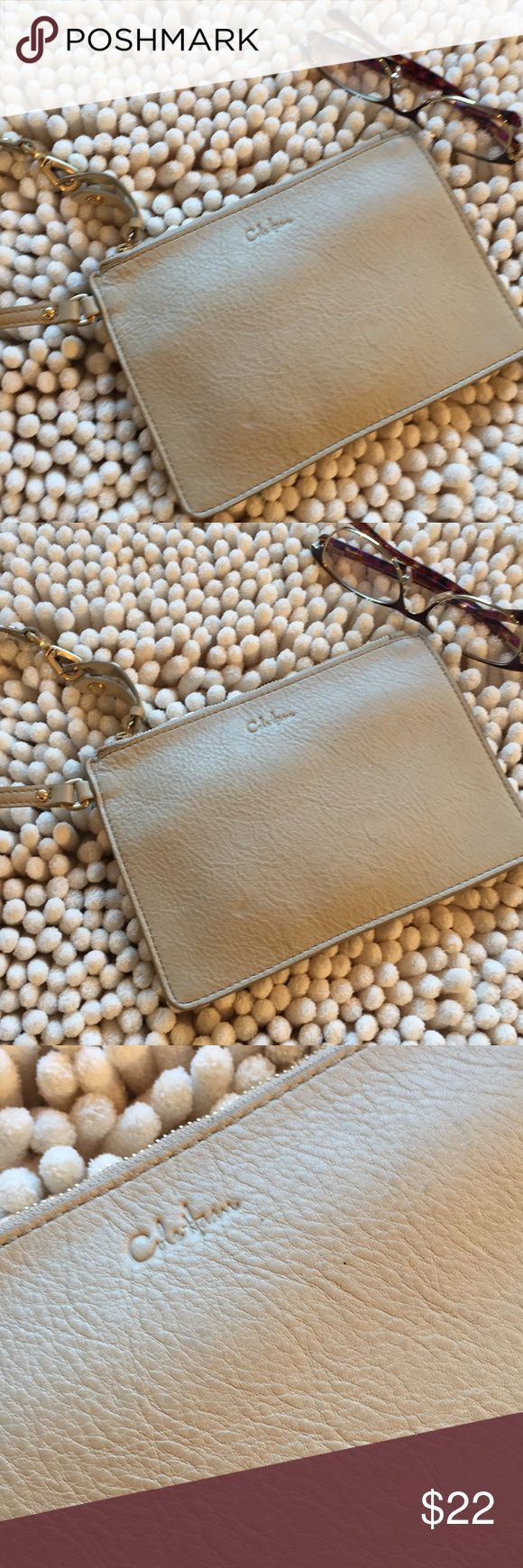 Cole Haan Leather Neutral Color Wristlet Great condition interior is spotless and clean gold hardware 7 1/2 inches wide 5 1/2 inches deep zips close all leather super cute great basic no rips no tears no stains non-smoking environment 💕 Cole Haan Bags Clutches & Wristlets
