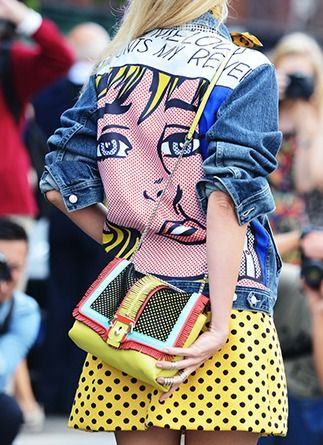 Loving this pop art denim jacket and yellow polka dot skirt outfit!!!Spring '14 Milan Fashion Week. Photo by Tommy Ton. Details in street style