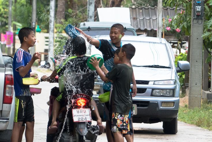 teenagers throw water over each other in Nakhon Si Thammarat