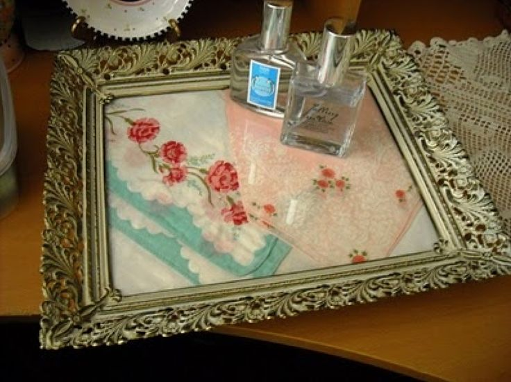 Put vintage hankies in an old frame for a cute tray!!