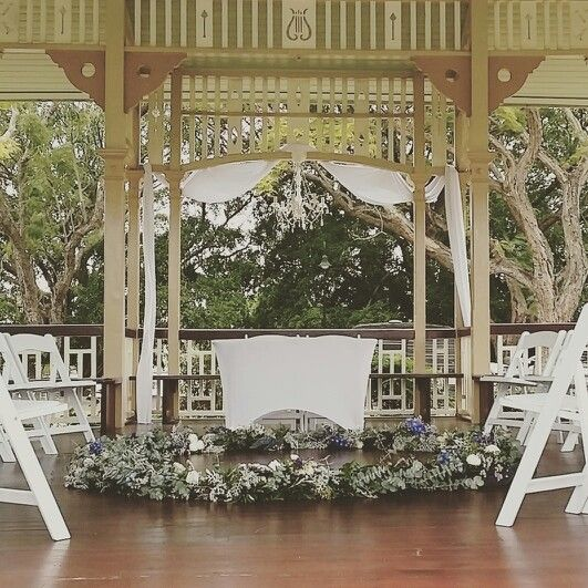 An amazing circular ceremony at New Farm Park Rotunda in Brisbane with a lush floral wreath where the bride and groom became husband and wife ♡ www.brisbaneweddingdecorators.com.au