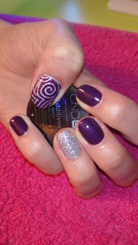 Rock Royalty CND Shellac with silver glitter feature nail & carved out pattern on thumb