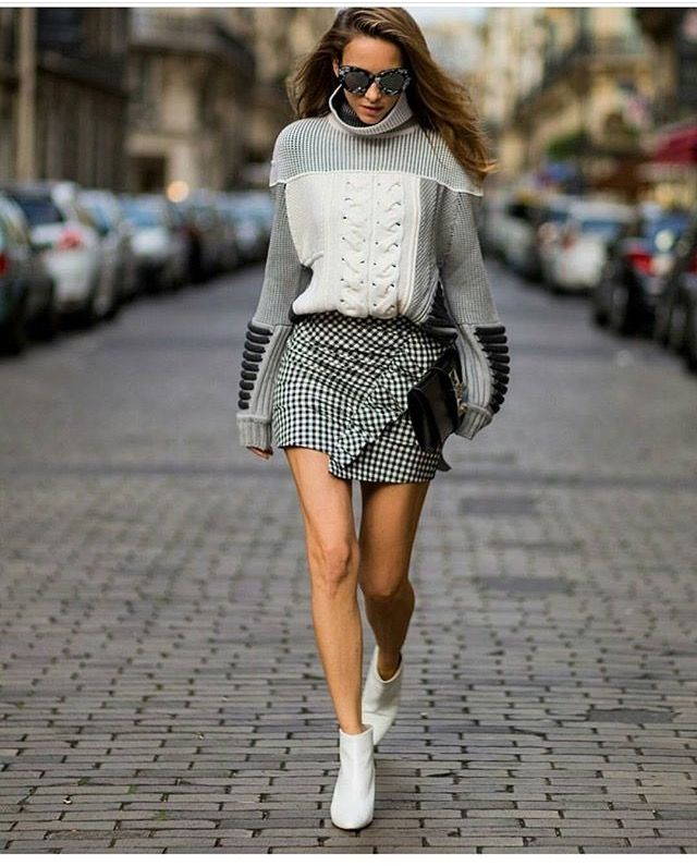Patchwork sweater, houndstooth skirt.