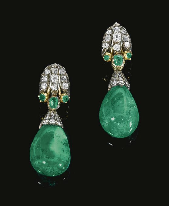 Pair of emerald and diamond earrings, composite circa 1870 and later. Each surmount of stylized lotus design, set with rose, cushion shaped and single cut diamonds and circular cut and cushion shaped emeralds, circa 1870, suspending an emerald drop capped with rose stones.