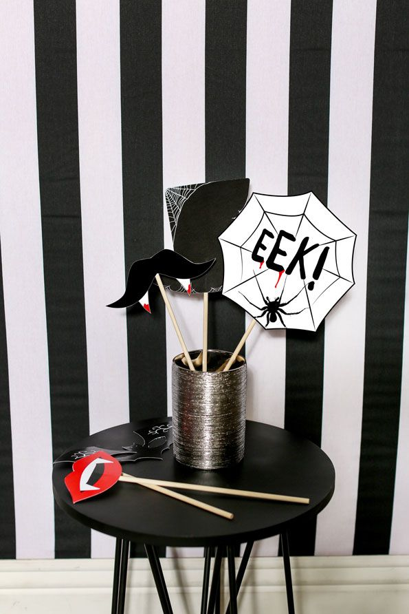 Everyone loves a fun and festive photo booth. To make your own Halloween photo booth backdrop, hang a piece of black-and-white striped fabric against an empty wall complete with printable photo props. Plan your own bloody good time with these tips, brought to you by Evite in partnership with NABISCO #ad #GhostessParty