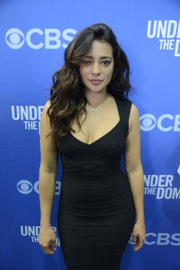 Natalie Martinez Natalie Martinez walks the red carpet at the Under The Dome premiere.