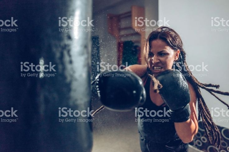 Female kickboxer training with a punching bag royalty-free stock photo
