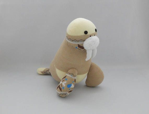 This lovely walrus plush toy is made out of light brown socks with cream color blocks and brown/white/blue fair isle patterns and a white fuzzy sock. He has button eyes, embroidered mouth and nose. Everything at Sock Sock World is made with much care, love and pride. I use only brand