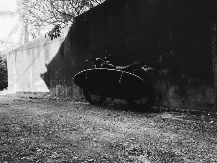 custom motorbike with black surfboard #surf #custombike #japstyle #motorcycle #black #Bali #surfboard #b&w #photo