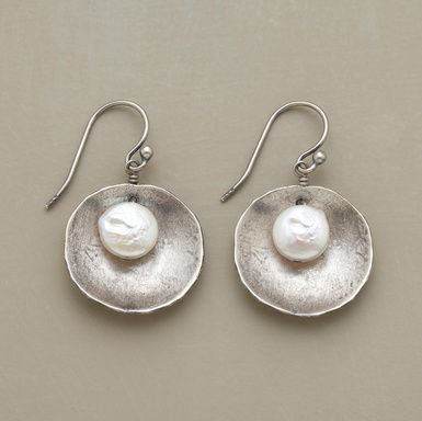 """Freshwater cultured coin pearls nestle inside flat """"shells"""" of brushed, oxidized sterling silver, suspended from silver French wires. Pearls may vary in size and color. Imported. Exclusive. 1""""L."""