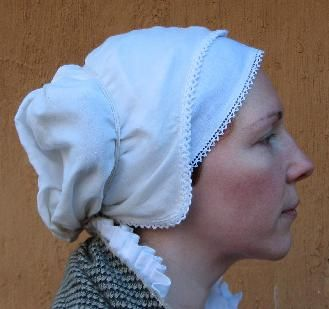How to wear a Tudor coif - Debunking the two-part coif and showing how to wear a one-piece coif securely.