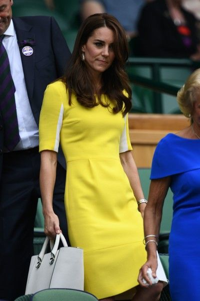 Kate Middleton Photos - Britain's Catherine, Duchess of Cambridge arrives in the royal box on centre court during the women's semi-final matches on the eleventh day of the 2016 Wimbledon Championships at The All England Lawn Tennis Club in Wimbledon, southwest London, on July 7, 2016. / AFP / GLYN KIRK / RESTRICTED TO EDITORIAL USE - Day Ten: The Championships - Wimbledon 2016