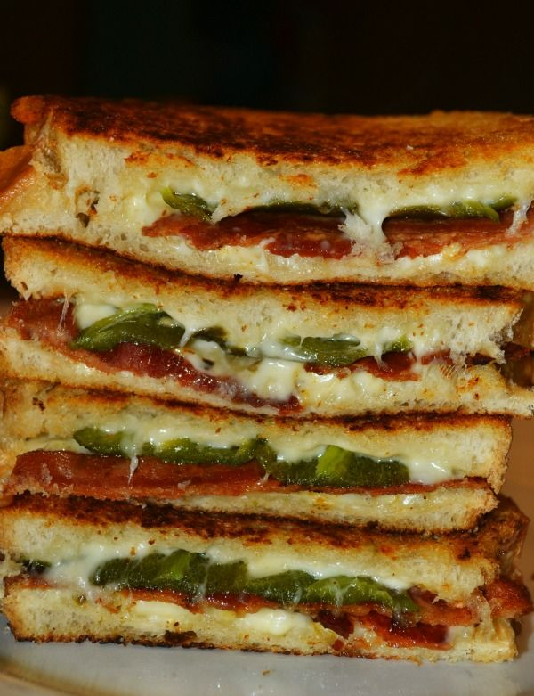 Bacon & Jalapeno Popper Grilled Cheese Sandwiches - I can never go back to normal grilled cheese sandwiches after eating these!!   8-10 jalapenos (depending on the size…8 if large, more if not)  8 slices texas toast  8oz cream cheese, softened  2 cups Mont. Jack cheese, shredded  10 thick slices cooked,crispy bacon  butter