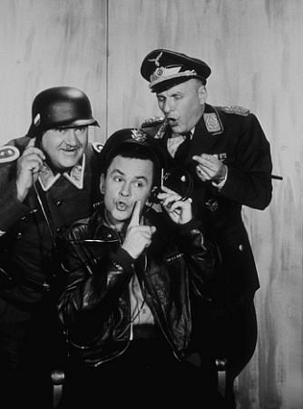 Comedy from 1965-1971, set in a NAZI POW camp. Seargent Shultz (John Banner), Colonel Hogan (Bob Crane) and Colonel Klink (Werner Klemperer)