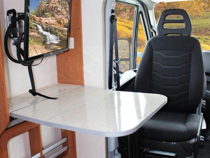 The C7184 Ceduna motorhome has a fold out table cleverly positioned behind the passenger's chair. The chair can be swiveled around to face toward the inside of the motorhome. This makes the fold down table a handy desk or workstation and a great place to use your laptop or read large maps.
