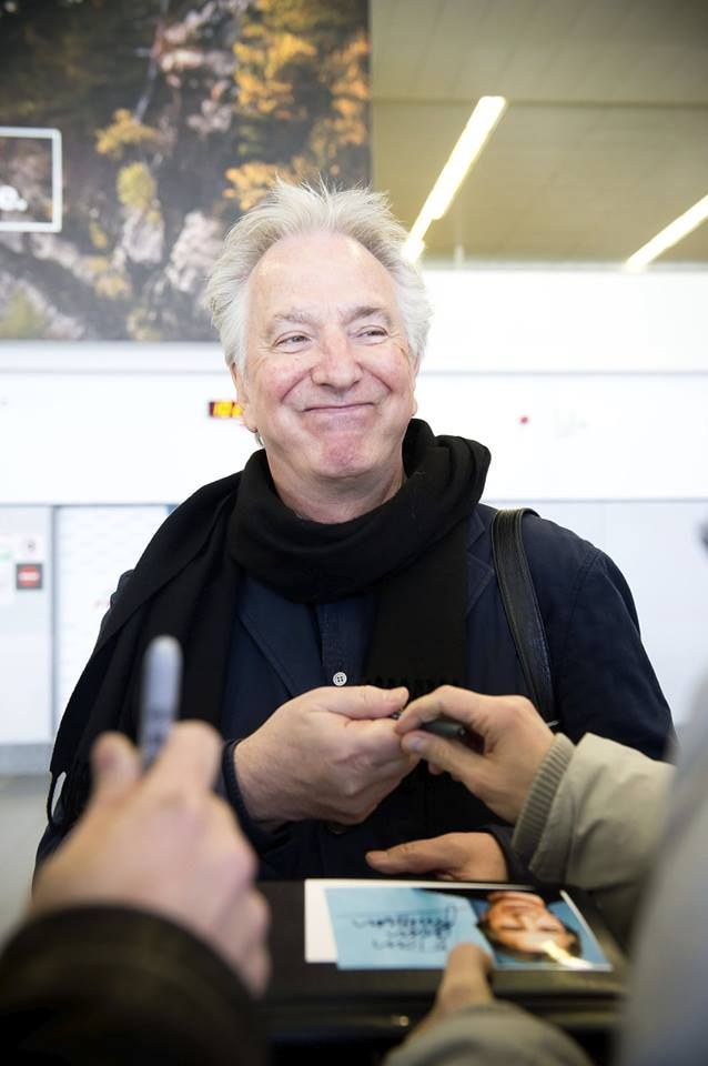March 19, 2015 -- Alan Rickman arriving in Prague. This photo makes me smile.