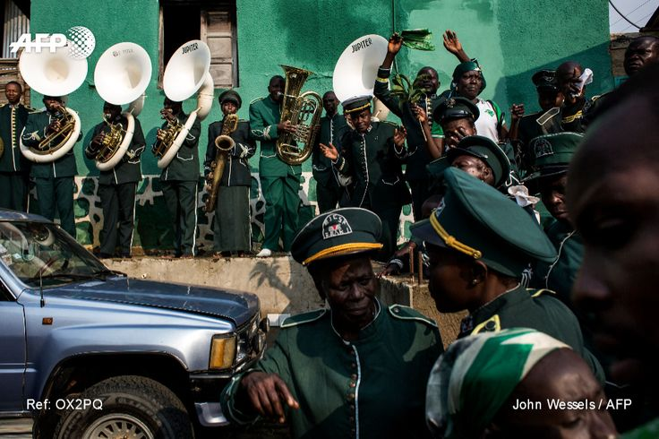 An orchestra of Kimbanguist faithfuls play music during christmas celebrations on May 25, 2017 in Nkamba. JOHN WESSELS / AFP