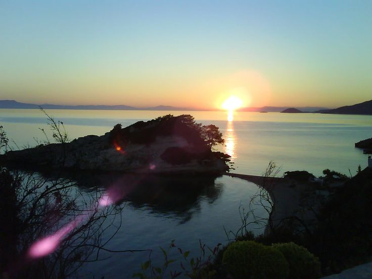 Sunrise by the sea. Summer on the Greek islands. Great fun nights out. Being young. Kokkari, Samos, Greece