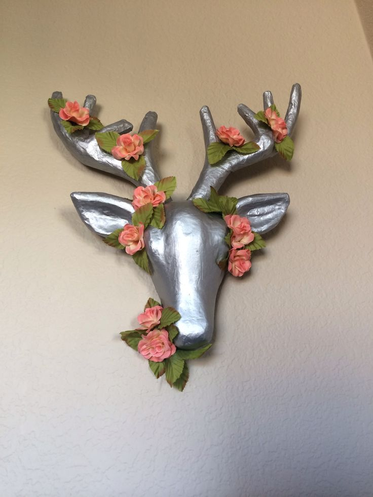 DIY Deer Decor! Michaels paper mâché deer head + silver paint. Paint the deer head in several coats of paint & hot glue flower blossoms and greenery around the head and antlers. Voila! You have an affordable, adorable feminine-masculine piece to spice up your home! In love!