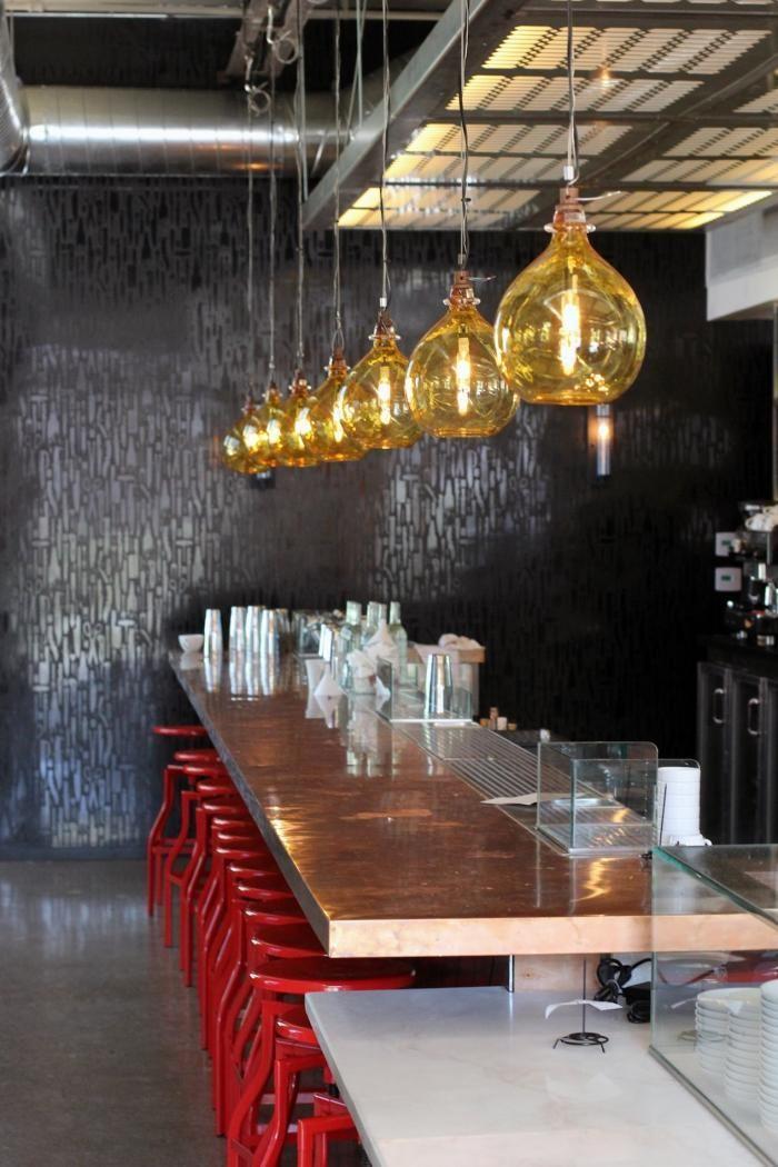 Bestia restaurant LA counter with red stools Los Angeles Hotel Interior Designs