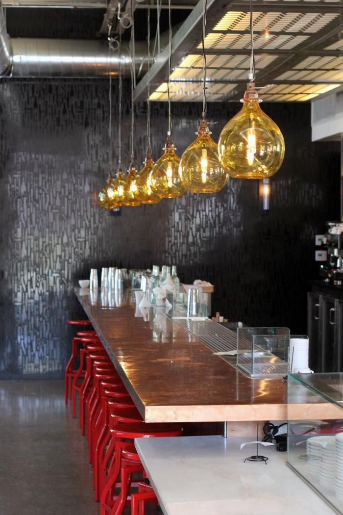 Bestia restaurant LA counter with red stools Los Angeles Hotel Interior Designs