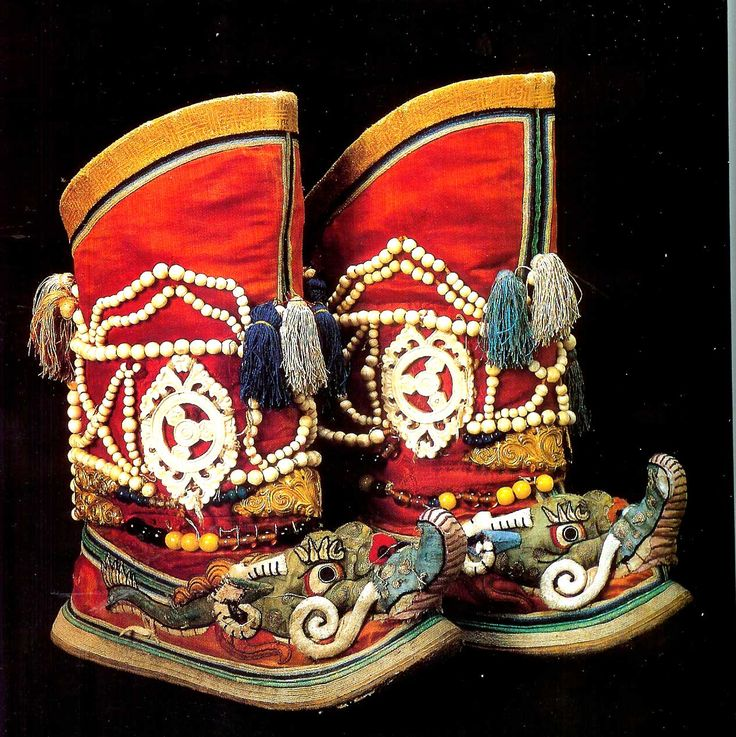 Boots for the Tsam ritual dance, with carved bone details. Mongolia