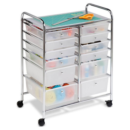 """Twelve Drawer Rolling Cart in White Original $114.99 $79.99 Item HONCRT01683  Keep yourself organized! Rolling cart features two rows with six plastic drawers in ascending size order Steel table at top Handles at each side for easy maneuvering Wheels Dimensions: 31.75""""H x 25.25""""W x 15.25""""D Color: White Composition: Chrome Plated Steel, Plastic Origin: Taiwan Wipes Clean With Damp Rag"""