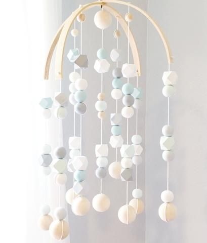 Slightly sophisticated, a touch whimsical, and all modern, our wooden geo mobile captures the beauty and simplicity of classic Scandinavian design. Each Geo Mobile features a combination of hand paint