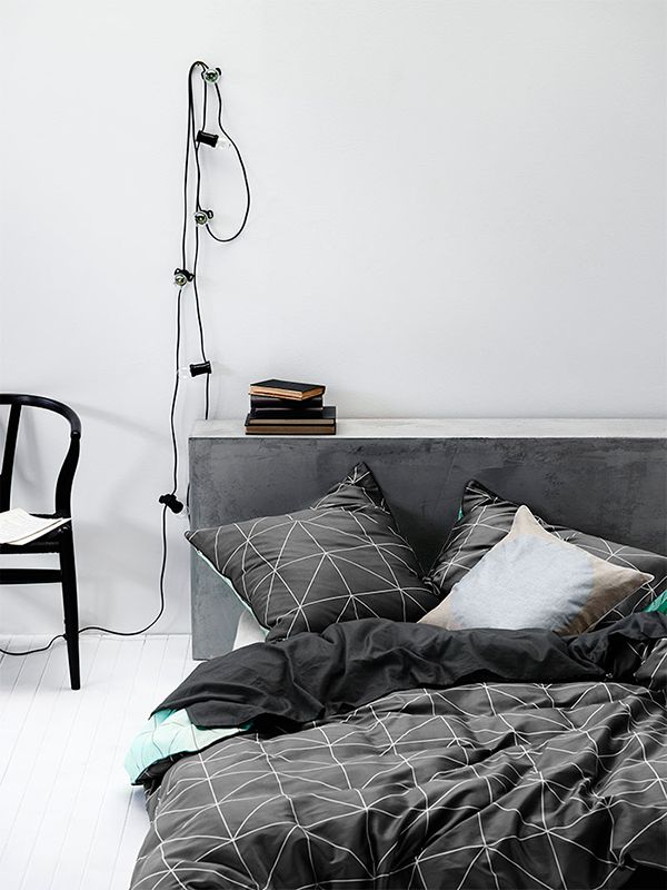 Bedroom with white walls and grey bedding